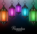 Lanterns Background in Colorful Glowing Lights with Ramadan Kareem Royalty Free Stock Photo