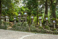 Lanterns in nara way leading to a shinto shrine kasuga taisha with many traditional japan Royalty Free Stock Image