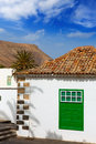 Lanzarote Yaiza white village houses green window Stock Image