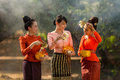 Laos woman splashing water durin tradition festival Songkran fes Royalty Free Stock Photo