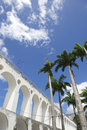 Lapa arches rio de janeiro brazil under bright tropical blue sky with palm trees Stock Images