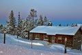 Lapland suset wooden cottage in the winter s evening finland Royalty Free Stock Photography