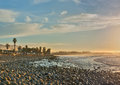 Lapping ocean water wetting the rocks rocky shoreline of ventura beach at high tide Stock Photos