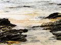 Lapping waves a close up view of small on a rocky shore Royalty Free Stock Image