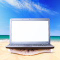 Laptop on beach Royalty Free Stock Photo