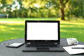 Laptop with blank screen outdoors Royalty Free Stock Photo