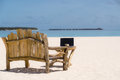 Laptop blank screen on wooden desk with beach. relax concept.