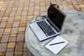 Laptop on the cement table in park Stock Photography