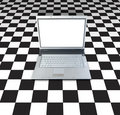 Laptop On Checker Board Royalty Free Stock Photo