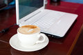 Laptop and coffee Stock Images