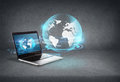 Laptop computer with globe hologram on screen Royalty Free Stock Photo