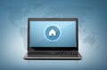 Laptop computer with house button on screen Royalty Free Stock Photo