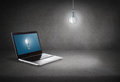 Laptop computer with light bulb on screen technology and advertisement concept Stock Photo