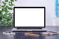 Laptop computer mockup with blank screen on office desk Royalty Free Stock Photo