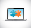 Laptop computer and puzzle pieces Royalty Free Stock Photo