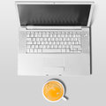 Laptop and cup of coffee on table view from above Royalty Free Stock Photography