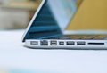 Laptop edge side view with ports half opening Royalty Free Stock Photo