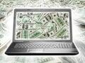 Laptop full of dollars Stock Images