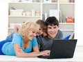 Laptop for happy family at home Royalty Free Stock Photos