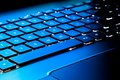 Laptop keyboard as a background toned to blue Royalty Free Stock Photo