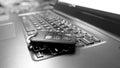 Laptop keyboard and  car key Royalty Free Stock Photo