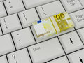 Laptop Keyboard With euro money Royalty Free Stock Photo