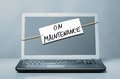 Laptop with maintenance note about Royalty Free Stock Photography