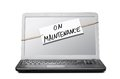 Laptop with maintenance note about Stock Photography