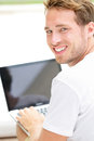 Laptop man smiling happy using computer pc outside young white joyful caucasian model lifestyle image Stock Photography