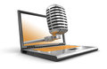 Laptop and microphone clipping path included image with Stock Images