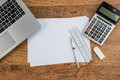 Laptop, paper pen Ruler Calculator and Eraser on work desk Royalty Free Stock Photo