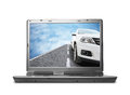 Laptop pc with a image of car isolated on white Royalty Free Stock Photography