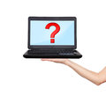 Laptop with question mark in hand Royalty Free Stock Image