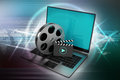 Laptop with reel Royalty Free Stock Photo