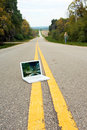 Laptop in Road with Woman Walking Away Royalty Free Stock Photo