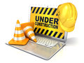 Laptop with safety helmet and traffic cones, concept of computer under construction Royalty Free Stock Photo