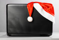 Laptop with santa hat Royalty Free Stock Photo
