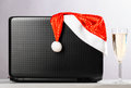 Laptop with santa hat and wine Royalty Free Stock Photo
