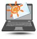 Laptop with at sign stylized as sun and mailing envelope Royalty Free Stock Photo