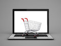 Laptop with small shopping cart Royalty Free Stock Photo
