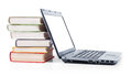 Laptop and a stack of old books Royalty Free Stock Photo