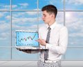 Laptop with stock chart businessman holding close up Stock Photos
