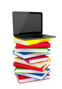 Laptop on top of stack of colorful books e learning concept a white background Royalty Free Stock Image