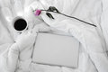 Laptop, white cup of coffee and purple rose isolated on white bed Royalty Free Stock Photo