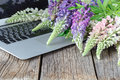 Laptop on wooden floor with flowers Royalty Free Stock Photo