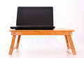 Laptop on a wooden table computer white background Stock Image