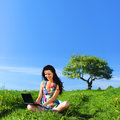 Laptop work in field green grass Stock Photo