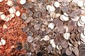 Numismatic background of uncirculated cents nickels and quarters Royalty Free Stock Photo