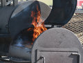 Large BBQ smoker with flames Royalty Free Stock Photo
