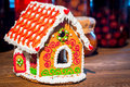 Large beautifully decorated gingerbread house a is on the table Stock Photo